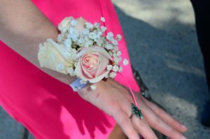 corsage pointing downward